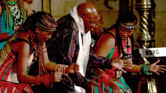 "Tutu dances at the launch of his biography ""Tutu: The Authorised Portrait"" in 2011."