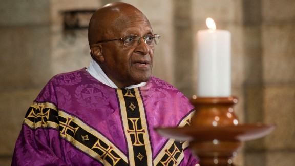 Tutu leads a service in Cape Town after Mandela's death in 2013.