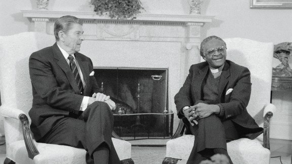 """US President Ronald Reagan meets with Tutu in the White House Oval Office in December 1984. Tutu denounced the Reagan administration's policy toward the South African government as """"immoral"""" and """"un-Christian."""""""