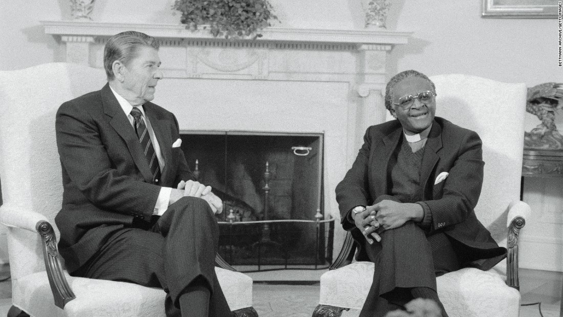 "US President Ronald Reagan meets with Tutu in the White House Oval Office in December 1984. Tutu denounced the Reagan administration's policy toward the South African government as ""immoral"" and ""un-Christian."""