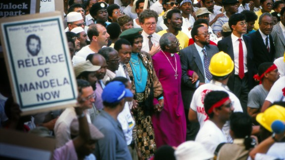 Tutu and Winnie Mandela march in Cape Town to protest the continued imprisonment of anti-apartheid leader Nelson Mandela in February 1990. Later that day, South African President F.W. de Klerk would announce Mandela's release.