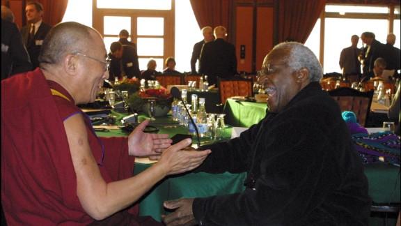 Tutu and the Dalai Lama attend the Nobel Peace Prize Centennial Symposium in 2001.