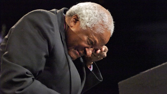 """Tutu wipes away tears after hearing Peter Gabriel sing """"Biko"""" in Johannesburg in 2007. The song is about the death of anti-apartheid activist Steve Biko."""