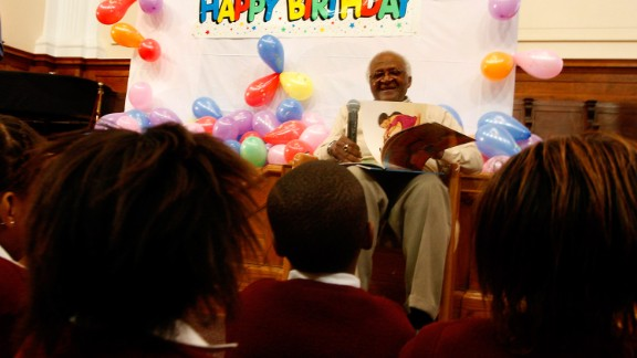 """Children in Cape Town sing """"Happy Birthday"""" to Tutu as he celebrates his 78th birthday in 2009."""