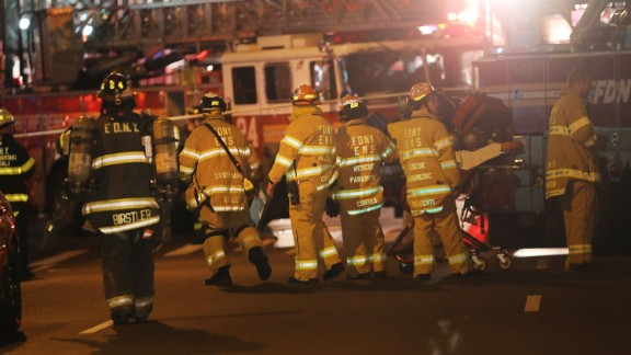 NEW YORK, NY - SEPTEMBER 17:  Police, firefighters and emergency workers gather at the scene of an explosion in Manhattan on September 17, 2016 in New York City. The evening explosion at 23rd street in the popular Chelsea neighborhood injured over a dozen people and is being investigated. (Photo by Spencer Platt/Getty Images)