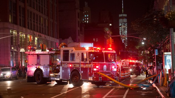 TOPSHOT - A fire truck is seen near a blocked off road near the site of an alleged bomb explosion on West 23rd Street on September 17, 2016, in New York. An explosion in New York