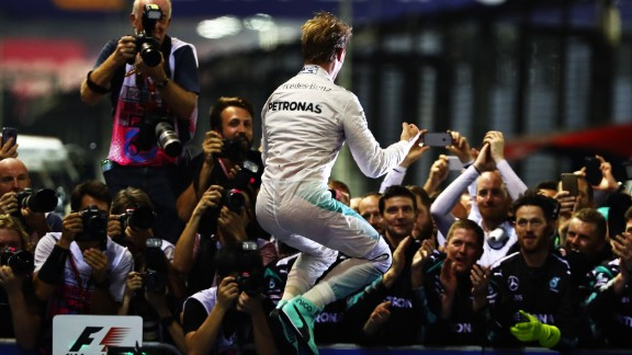 Nico Rosberg of Germany celebrates his Singapore GP win in parc ferme.