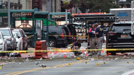 "NEW YORK, NY - SEPTEMBER 18: FBI agents review the crime scene of remnants of bomb debris on 23rd St. in Manhattan's Chelsea neighborhood on September 18, 2016 in New York City. An explosion that injured 29 people that went off in a construction dumpster is being labeled an ""intentional act"". A second device, a pressure cooker, was found four blocks away that an early investigation found was likely also a bomb. (Photo by Stephanie Keith/Getty Images)"
