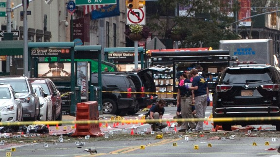 """NEW YORK, NY - SEPTEMBER 18: FBI agents review the crime scene of remnants of bomb debris on 23rd St. in Manhattan's Chelsea neighborhood on September 18, 2016 in New York City. An explosion that injured 29 people that went off in a construction dumpster is being labeled an """"intentional act"""". A second device, a pressure cooker, was found four blocks away that an early investigation found was likely also a bomb. (Photo by Stephanie Keith/Getty Images)"""