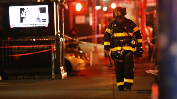 NEW YORK, NY - SEPTEMBER 17:  Police, firefighters and emergency workers gather at the scene of an explosion in