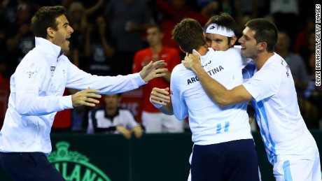 Argentina's tennis players celebrate Mayer's decisive victory in the Davis Cup semifinal against Britain.