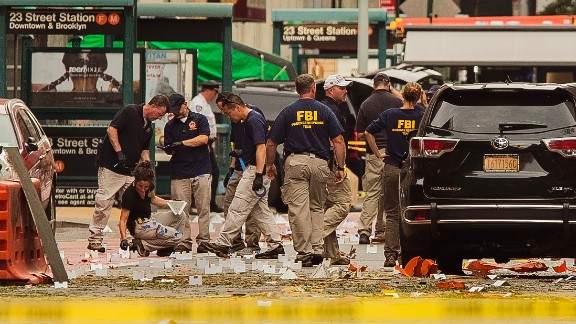 Members of the Federal Bureau of Investigation (FBI) carry on investigations at the scene of Saturday's explosion on West 23rd Street and Sixth Avenue in Manhattan's Chelsea neighborhood, New York, Sunday, Sept. 18, 2016. An explosion rocked the block of West 23rd Street between Sixth and Seventh Avenues at 8:30 p.m. Saturday. Officials said more than two dozen people were injured. Most of the injuries were minor. (AP Photo/Andres Kudacki)