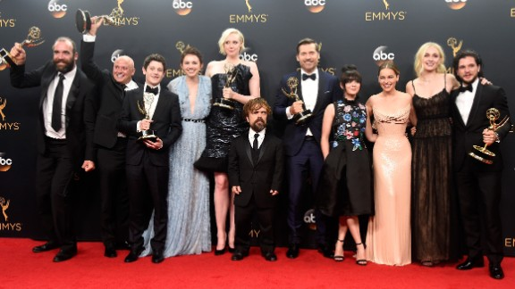 "The cast of the ""Game of Thrones"" celebrate their win for Best Drama Series."
