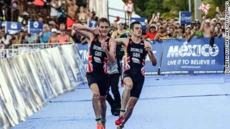 Triathlete helps his brother across the finish line