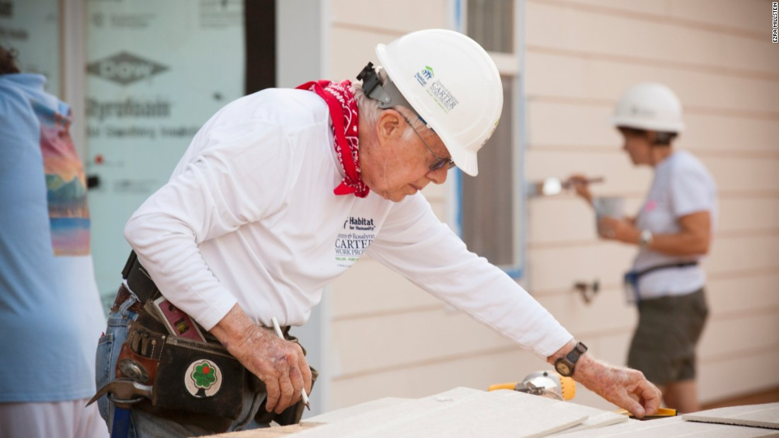 Jimmy Carter helps install siding on a new home during the 2014 Jimmy & Rosalynn Carter Work Project in Fort Worth, Texas.
