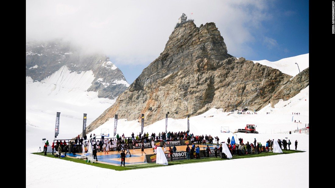 Professional basketball players, including NBA star Tony Parker, play on the Aletsch Glacier in the Swiss Alps on Wednesday, September 14. It was a promotional event for Tissot, one of Parker's sponsors.