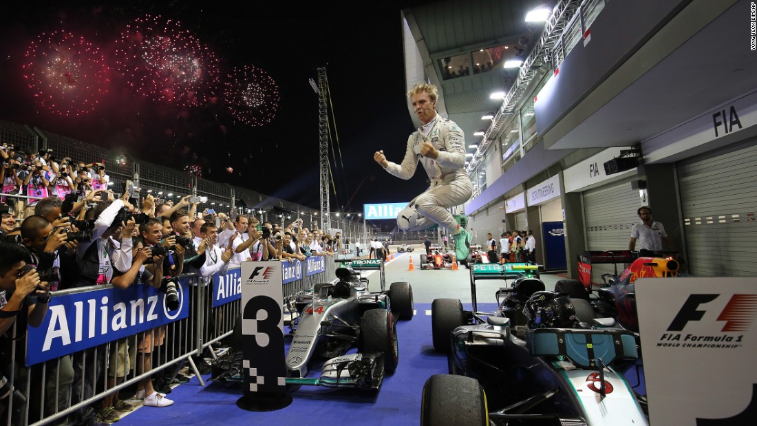 "Formula One driver Nico Rosberg jumps off his car as he celebrates <a href=""http://www.cnn.com/2016/09/18/motorsport/singapore-f1-rosberg-hamilton/index.html"" target=""_blank"">victory in the Singapore Grand Prix</a> on Sunday, September 18. It was the eighth win of the season for Rosberg, who reclaimed the standings lead from Mercedes teammate Lewis Hamilton."