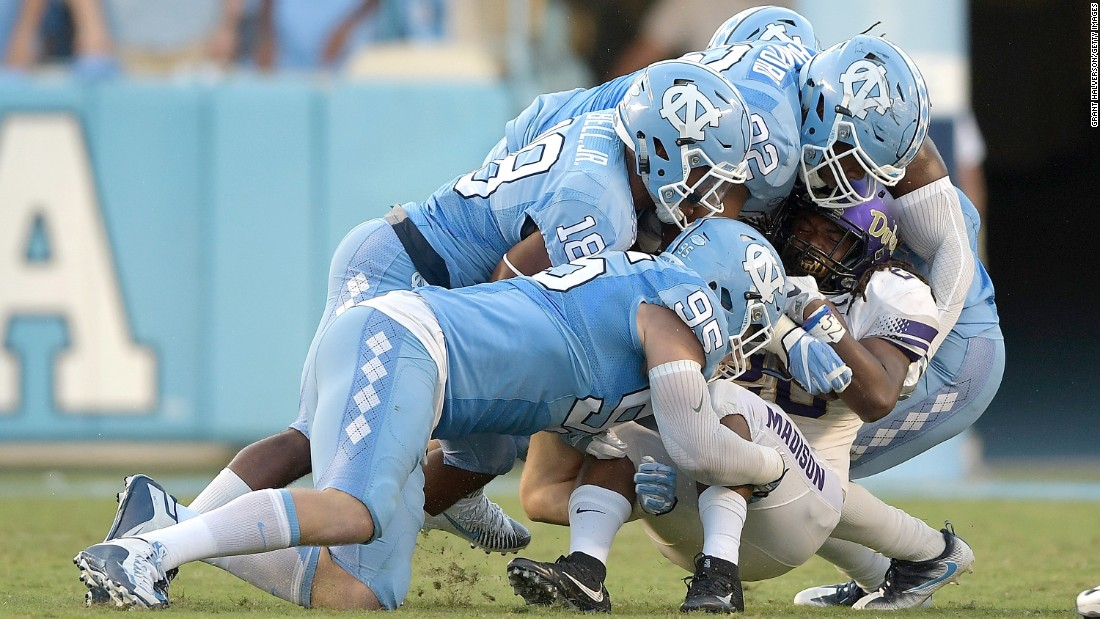 James Madison running back Cardon Johnson is gang-tackled by North Carolina Tar Heels during a college football game in Chapel Hill, North Carolina, on Saturday, September 17.