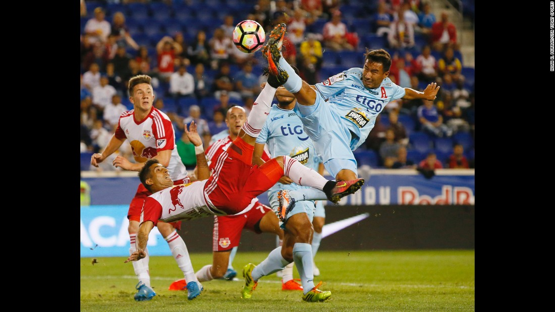 Alianza's Danny Torres, right, defends a bicycle kick by New York Red Bulls midfielder Gonzalo Veron during a CONCACAF Champions League match on Thursday, September 15.
