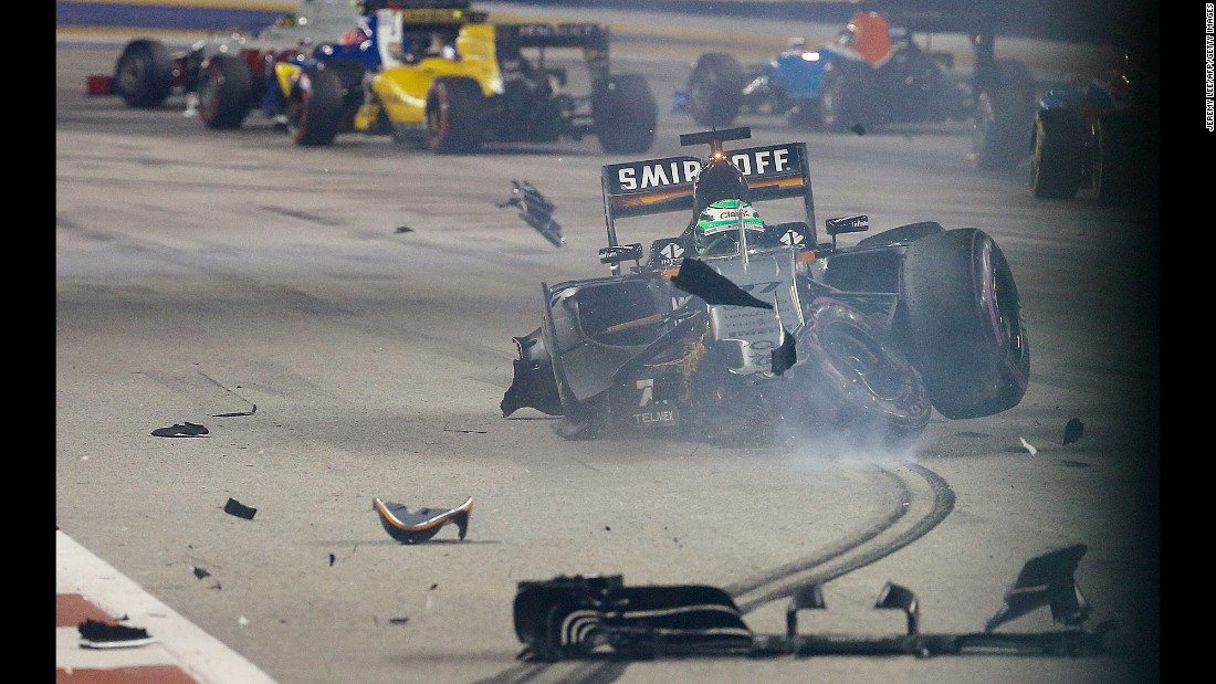 Formula One driver Nico Hulkenberg crashes at the start of the Singapore Grand Prix on Sunday, September 18. He was not hurt.