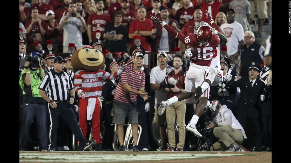 "Ohio State wide receiver Noah Brown pins the ball against the back of Oklahoma defender Michiah Quick as he <a href=""http://bleacherreport.com/articles/2664322-buckeyes-noah-brown-pins-football-against-defenders-back-for-the-touchdown"" target=""_blank"">catches a touchdown pass</a> in Norman, Oklahoma, on Saturday, September 17. Many are already calling it the catch of the season."