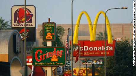 LOS ANGELES, CA - JULY 24:  Fast-food restaurants signs line a street July 24, 2008 in the South Los Angeles area of Los Angeles, California. The Los Angeles City Council committee has unanimously approved year-long moratorium on new fast-food restaurants in a 32-square-mile area, mostly in South Los Angeles, pending approval by the full council and the signature of Mayor Antonio Villaraigosa to make it the law. South LA has the highest concentration of fast-food restaurants of the city, about 400, and only a few grocery stores. L.A. Councilwoman Jan Perry proposed the measure to try to reduce health problems associated with a diet high in fast-food, like obesity and diabetes, which plague many of the half-million people living there.  (Photo by David McNew/Getty Images)