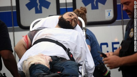Ahmad Rahami is taken into custody after a shootout with police Monday.