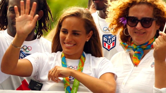 Tennis player Monica Puig waves to the crowd after arriving back in Puerto Rico from the Rio 2016 Olympics, where she became her country's first gold medalist.