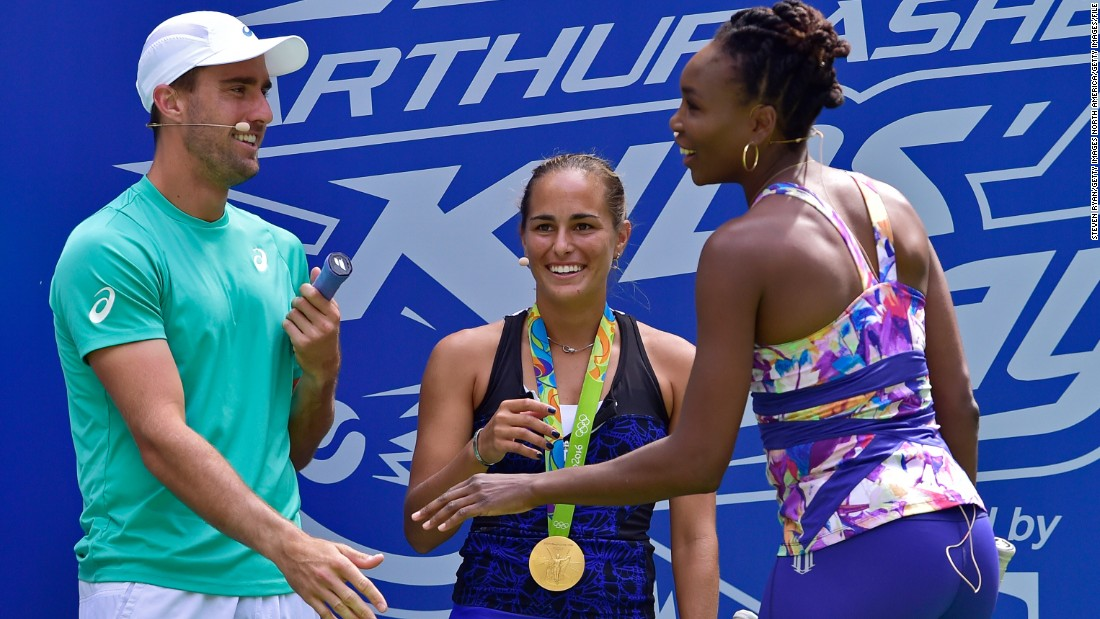 Puig took part in the Arthur Ashe Kids' Day with fellow tennis pros Steve Johnson and Venus Williams, but her first tournament after the Olympics ended with first-round defeats in both singles and doubles at the US Open.