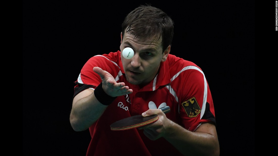 Germany's Timo Boll eyes the ball as he serves in a table tennis match against South Korea.