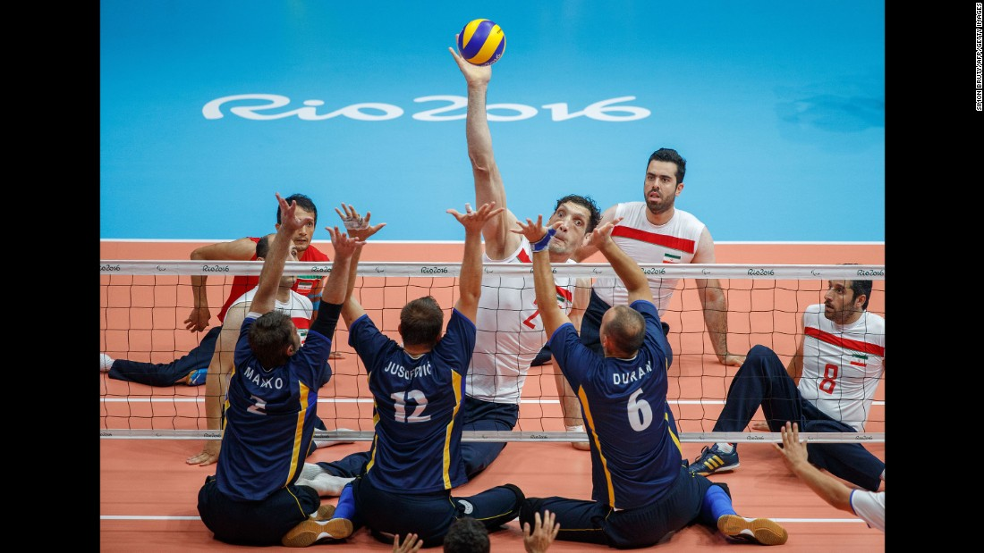 "Iran's Morteza Mehrzadselakjani, who is <a href=""http://edition.cnn.com/2016/09/15/sport/morteza-mehrzadselakjani-sitting-volleyball-iran/"" target=""_blank"">over 8 feet tall,</a> towers over opponents in the gold-medal match at the Paralympics. Iran defeated Bosnia-Herzegovina."