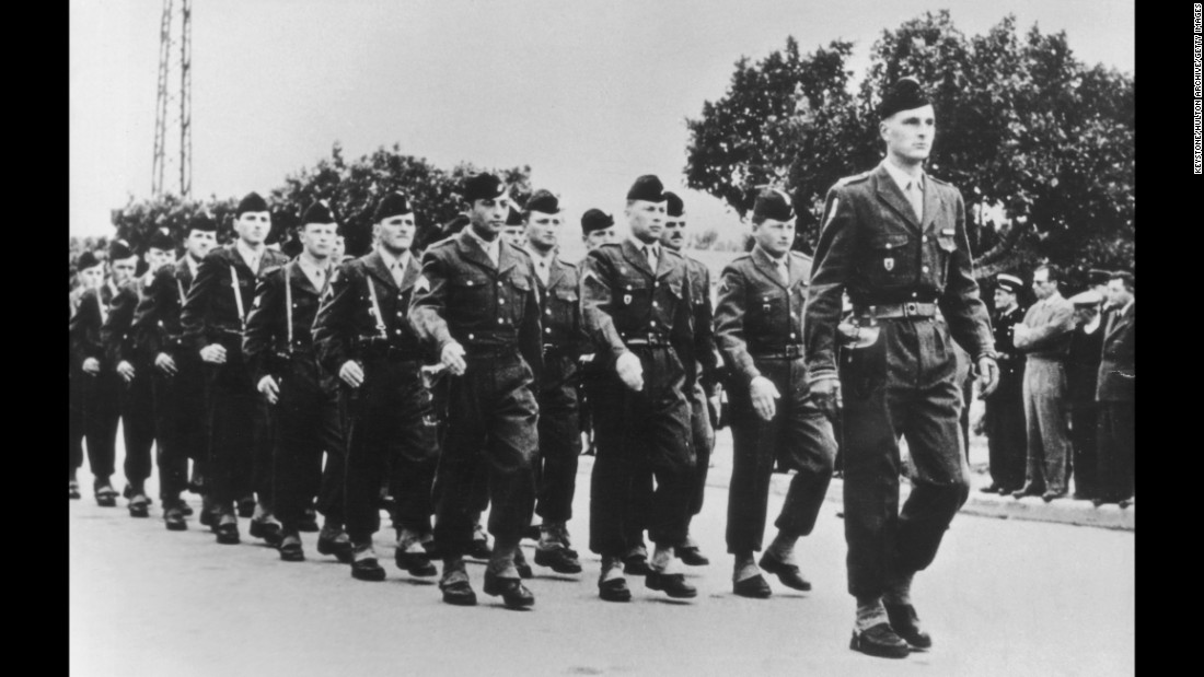 Chirac leads a French army regiment during a parade in 1956.