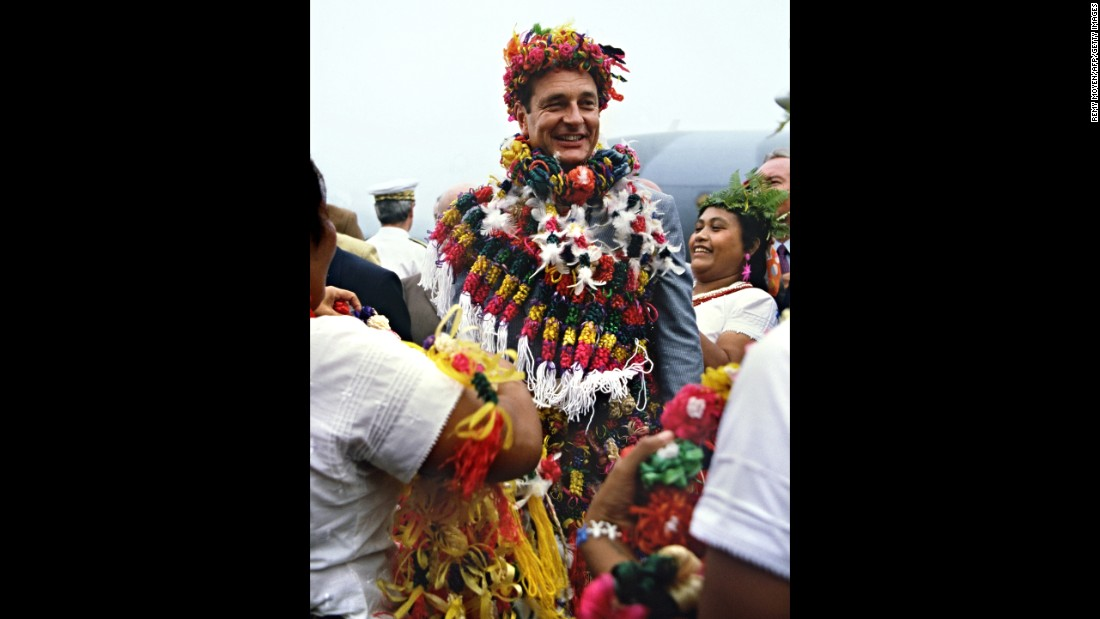Chirac wears traditional leis as he arrives at the South Pacific island of Wallis in 1986.