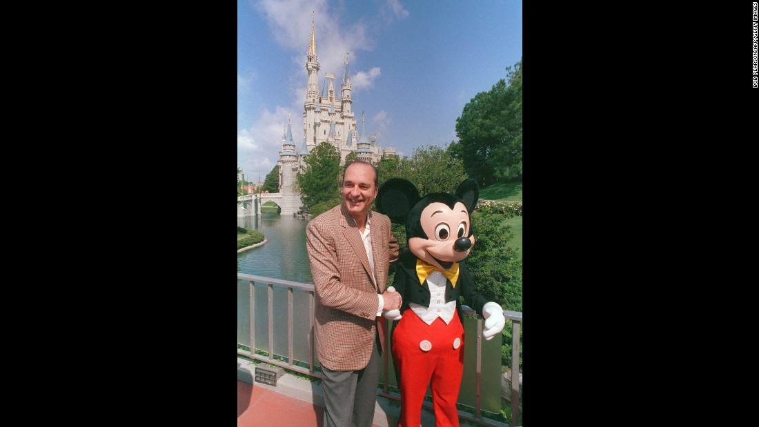 Chirac poses with Mickey Mouse during a trip to the United States in 1989.