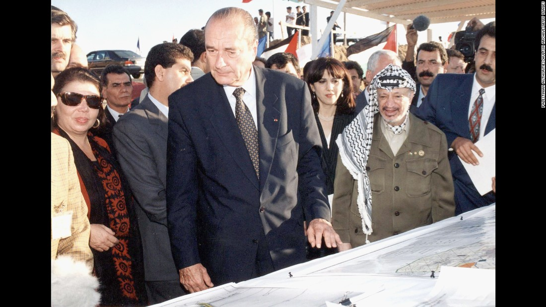 Chirac meets with Palestinian leader Yasser Arafat in Gaza City in 1996.
