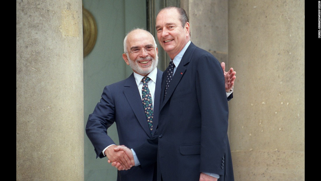 Chirac greets Jordan's King Hussein in Paris in 1997.