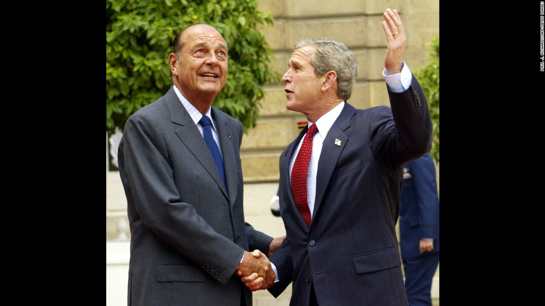 Chirac and U.S. President George W. Bush greet each other in Paris and look at the stormy skies overhead in 2002. Chirac was perhaps best known for his staunch opposition to the war in Iraq -- a position that put him at odds with Bush.