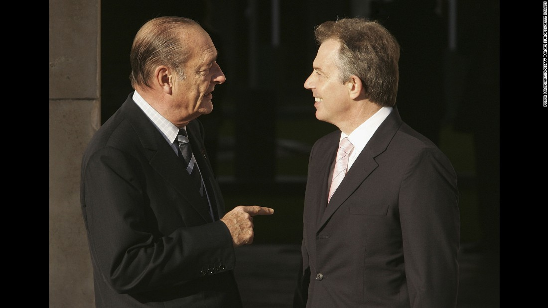 Chirac is welcomed by British Prime Minister Tony Blair in 2005.