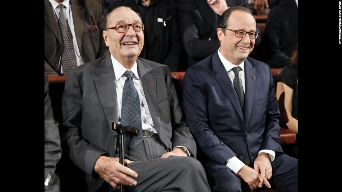 Chirac sits next to French President Francois Hollande during an award ceremony for the Jacques Chirac Foundation in 2014.