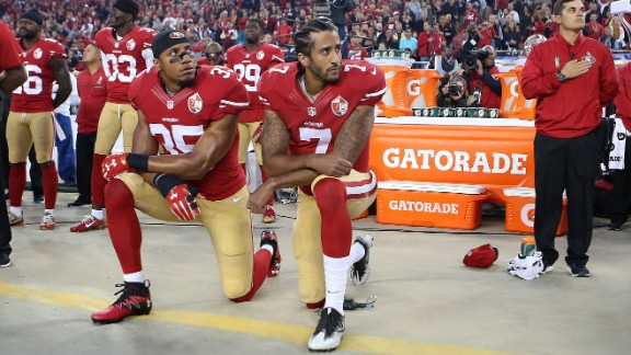 San Francisco 49ers Eric Reid and Colin Kaepernick take a knee during the National Anthem prior to their season opener against the Los Angeles Rams during an NFL football game on September 12, in Santa Clara, CA.