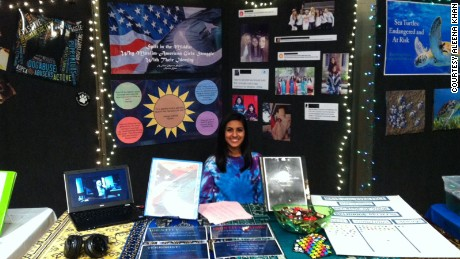 Aleena Khan presents her research on Muslim American teenagers at a Maryland school fair.