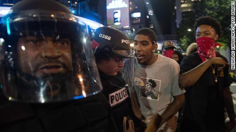 Protesters taunt riot police during a demonstration against police brutality in Charlotte, North Carolina, on September 21, 2016, following the shooting of Keith Lamont Scott the previous day.