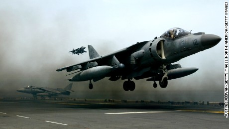PERSIAN GULF - APRIL 4 :  A U.S. Marine Harrier jet lands on the flight deck of the U.S.S. Bon Homme Richard April 4, 2003 in the Persian Gulf.  Harrier jets from the Bon Homme Richard continue to carry out bombing missions in support of the U.S.-led in Iraq.  (Photo by Justin Sullivan/Getty Images)