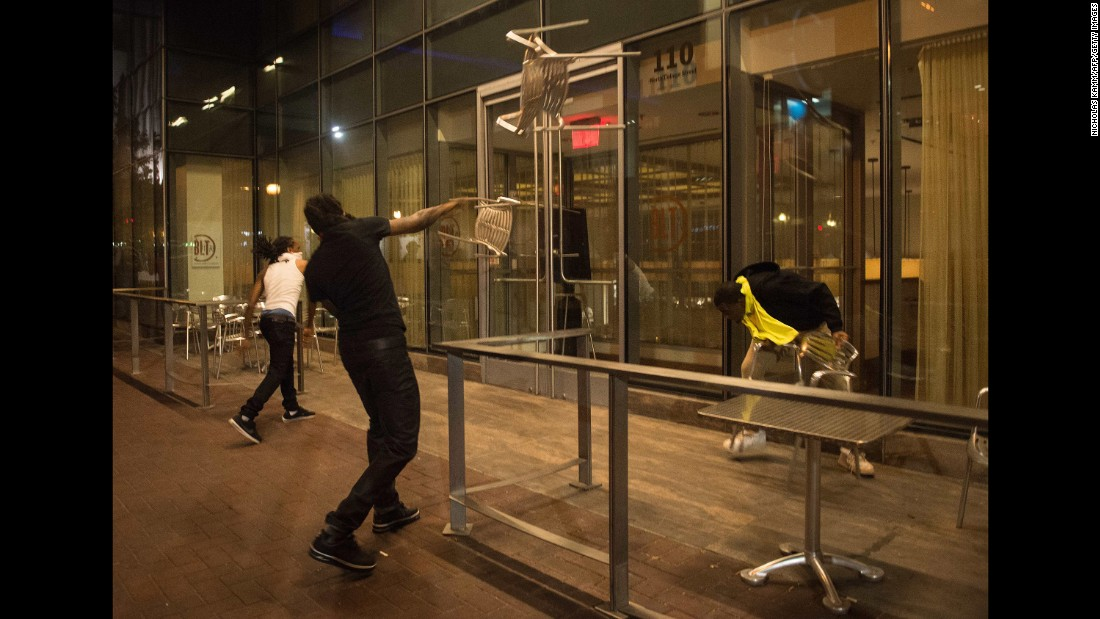 Protesters throw chairs at a restaurant on September 21.