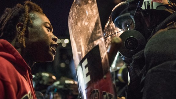 A protester stares down law enforcement officers during protests on September 21.