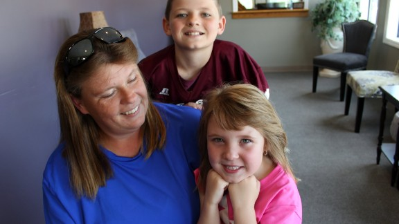 The Hill family, patients of Dr. Smith, show off their smiles