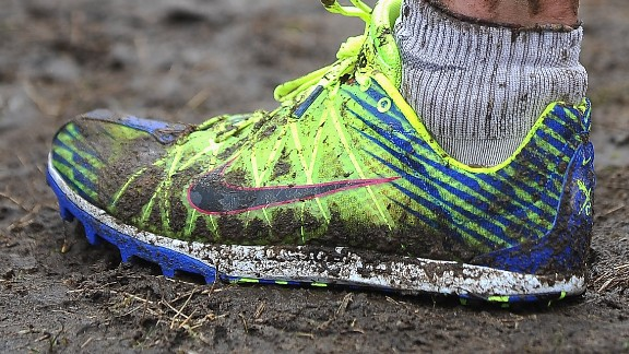 BYDGOSZCZ, POLAND - MARCH 24:  General view showing muddy legs and trainers during the Junior Womens Race during the 40th IAAF World Cross Country Championship 2013 on March 24, 2013 in Bydgoszcz, Poland.  (Photo by Christopher Lee/Getty Images)