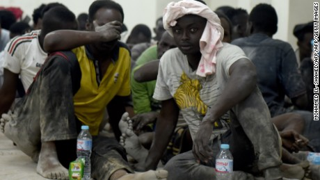 Survivors from a boat that capsized, off Egypt's north coast, sit in a police station in Rashid in northern Egypt, on September 21, 2016.  A boat carrying up to 450 migrants capsized in the Mediterranean off Egypt's north coast on, drowning 42 people and prompting a search operation that rescued 163 passengers, officials said. / AFP / MOHAMED EL-SHAHED        (Photo credit should read MOHAMED EL-SHAHED/AFP/Getty Images)