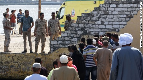 People gather in Rashid, as the search and rescue operation continues on Thursday September 22.