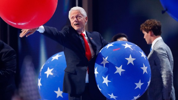 Former President Bill Clinton plays with balloons at the end of Democratic convention.